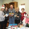 Leadership Rockwall gives back with gift cards for Helping Hands Toy Drive