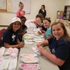 National Charity League Class of 2023 decorates socks for seniors