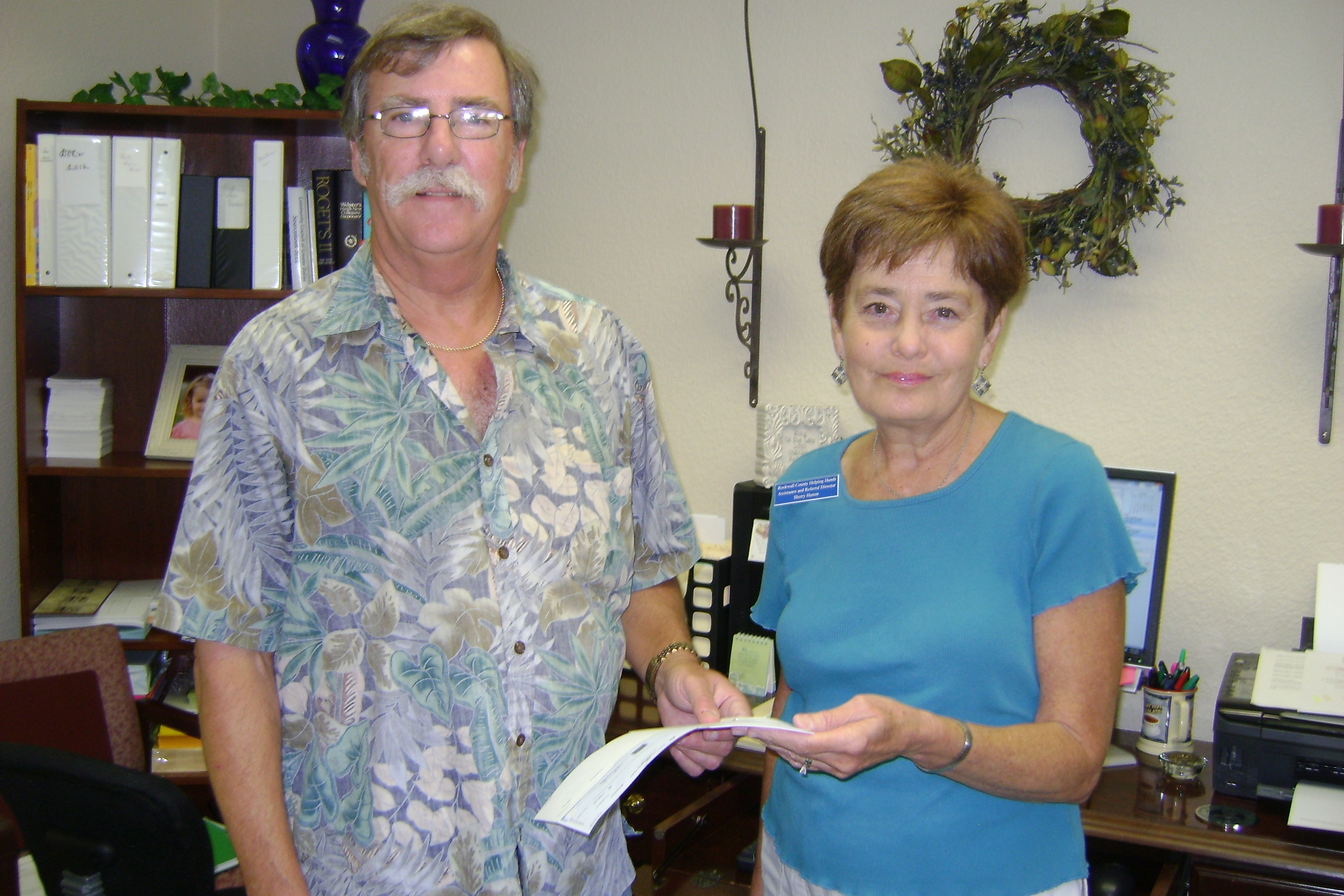 First Presbyterian Church presents donation to Helping Hands Food Pantry