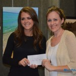 Katie Schneider (left) of Rockwall Ford presents 2nd place winner for the Water Media category Marie Gray with her $100 cash reward.