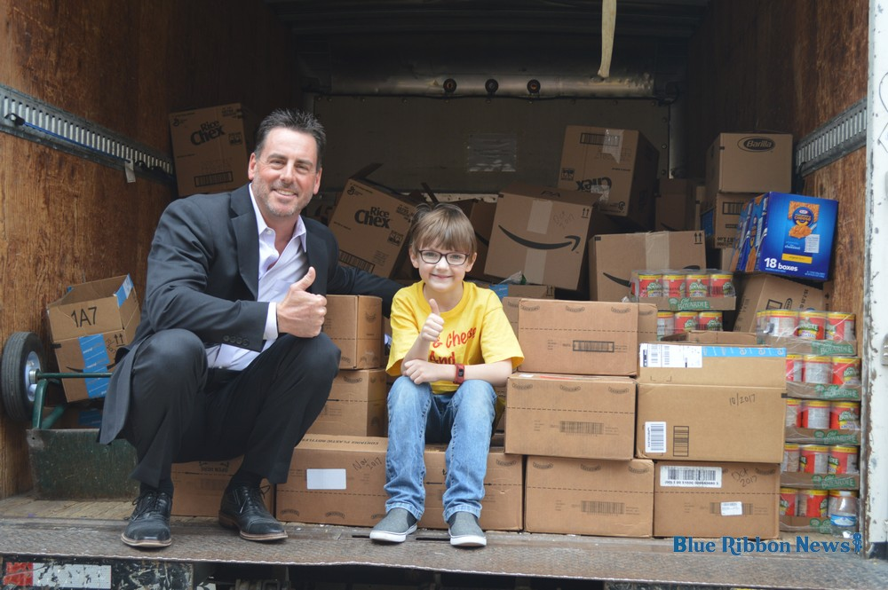Local boy's nonprofit collects thousands of food items for kids in need