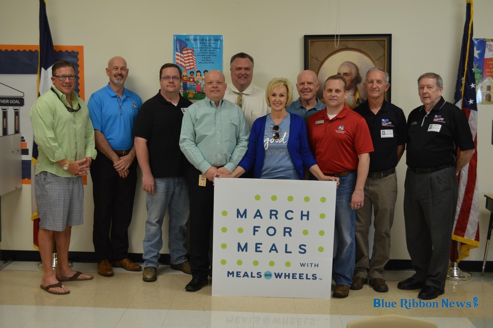 City officials deliver meals to homebound elderly during Community Champions Week