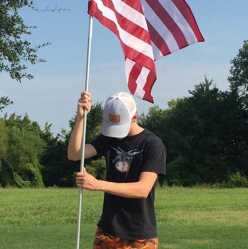 RHS Robotics team distributes American flags