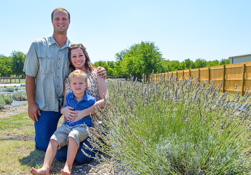 Kyle and Tera Griffin with their son Dean at their family farm, Prayer Lavender Garden.