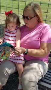 Reading books at the Little Free Library