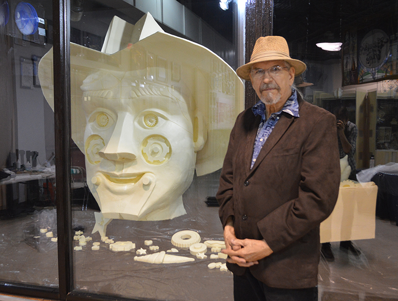 Artist Ken Robison with his 2018 State Fair of Texas Butter Sculpture