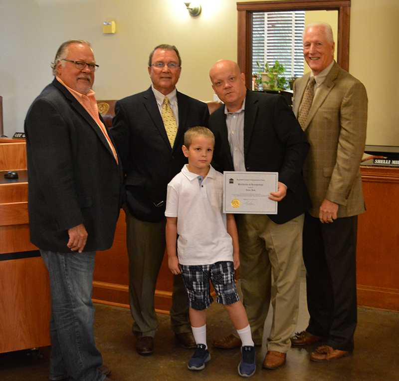 Commissioners Court and Fulton Academy second grader Dexter Shaw