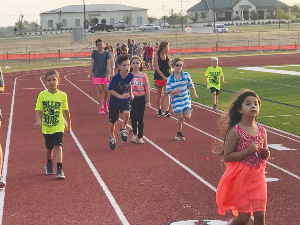 Pullen Elementary Running Club students hit the track.