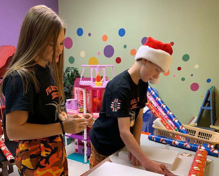 Rockwall High School Robotics Wraps Gifts for Rainbow Room