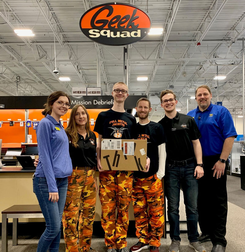 FRC 1296-Full Metal Jackets Scouting Subteam receives a team computer from Best Buy.
