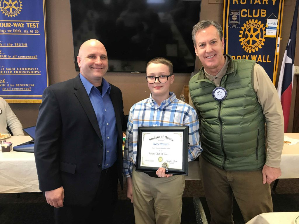 Shannon Elementary Principal Steven Pesek, Rotary Student of Honor Kevie Weaver, and Rotarian Kevin