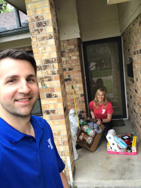 District Executive Director of the J.E.R. Chilton YMCA at Rockwall Clint Elliott and Membership Director Jocelyn Craig deliver the groceries to Sue.