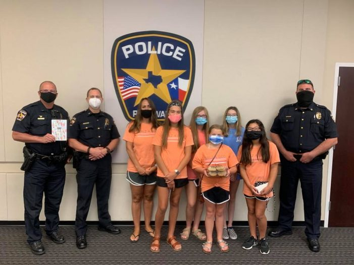 Stevenson Elementary Girls 4 God deliver sweet treats to Rockwall police