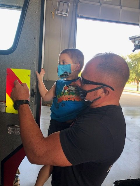 Easton's twin brother Jace takes a look inside a fire engine at Rockwall Fire Station #2.
