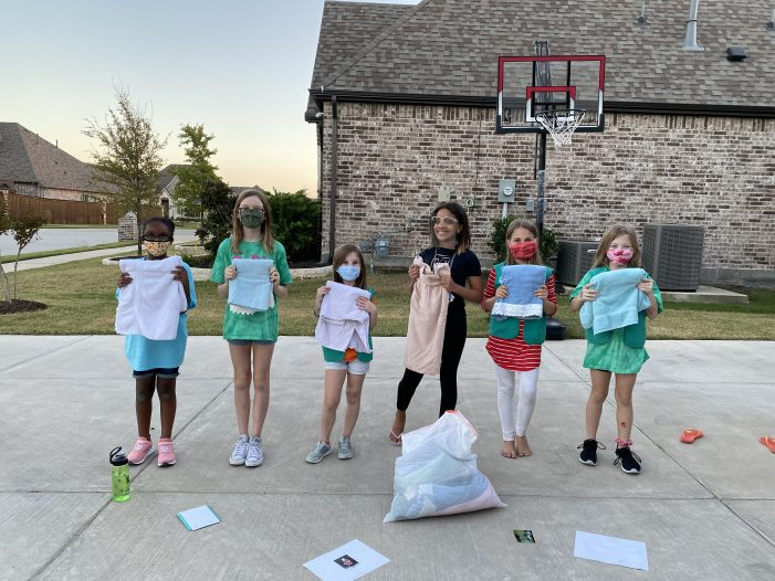 Girl Scout Junior Troop 7618 brings warmth and food to Rockwall Animal Shelter