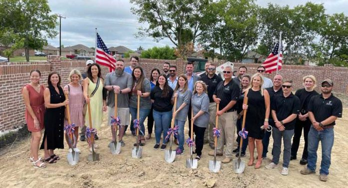 Local wounded veteran and his family surprised with a mortgage-free home