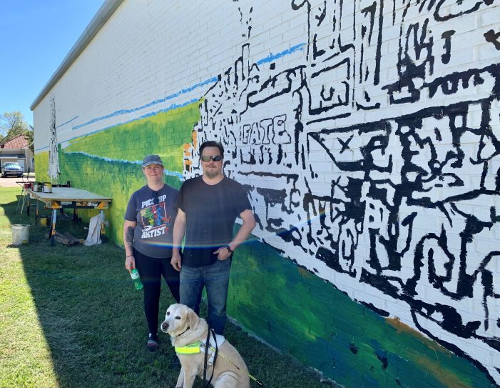 Painting the Town: Two mural artists – one who is blind – add colorful touches to Fate